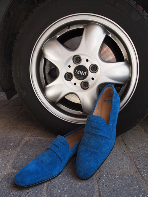 Don't you step on my blue suede shoes. Or drive on them.