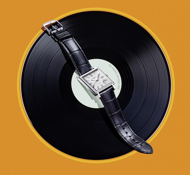 Nyheds-klokken fra Longines. Fås også i rødguld - og uden grammofonplade